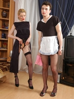 Salacious sissy French maid bobs up and down on babe's strap-on on the sofa