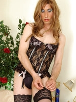 Lewd sissy puts on a lacy black corset aching for a ride on a rubber cock